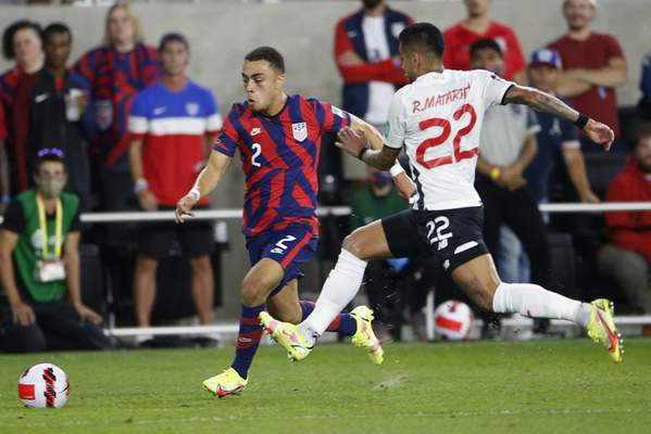 Associated Press The United States' Sergino Dest dribbles the ball upfield as Costa Rica's Ronald Matarrita defends during the first half of Wednesday's World Cup qualifying game in Columbus, Ohio.