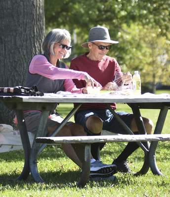 Katie Fyfe | The Journal Gazette Gale and Rick Evinger enjoy lunch together at Shoaff Park on a sunny, warm Wednesday.