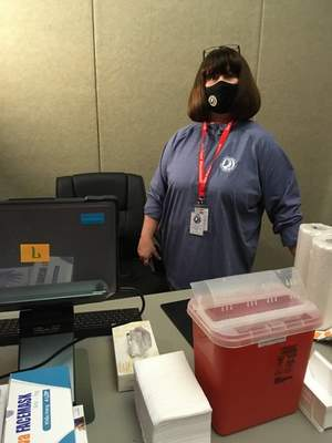 Rosa Salter Rodriguez  Allen County Health Department Administrator Mindy Waldron at a vaccination station at a clinic opening Monday at Memorial Coliseum.