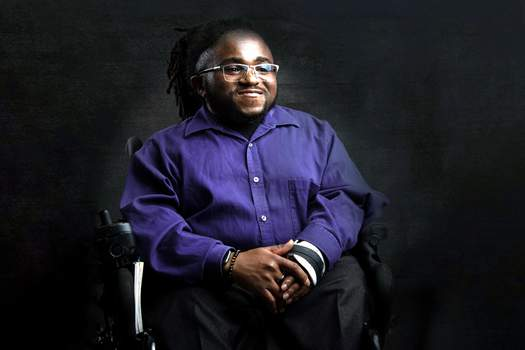 Jo'Male Collier has undergone 12 corrective surgeries for a genetic bone disorder. He is part of the happiness exhibit and says he doesn't chase happiness. (Picasa)