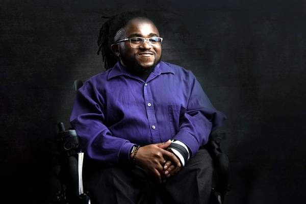 Jo'Male Collier has undergone 12 corrective surgeries for a genetic bone disorder. He is part of the happiness exhibit and says he doesn't chase happiness.
