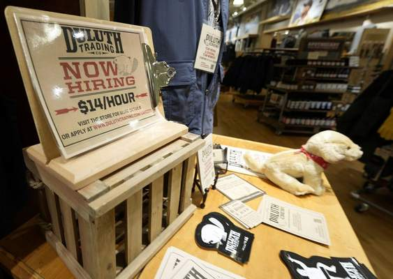 A now hiring sign sits on a display in a clothing store Saturday, Oct. 9, 2021, in Sioux Falls, S.D. (AP Photo/David Zalubowski)
