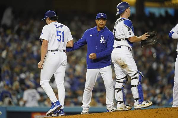 Los Angeles Dodgers pitcher Alex Vesia (51) is pulled by manager Dave Roberts, center, during the seventh inning of Game 4 of the baseball team's National League Division Series against the San Francisco Giants, Tuesday, Oct. 12, 2021, in Los Angeles. (AP Photo/Ashley Landis)