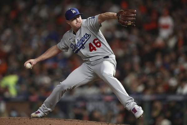 Los Angeles Dodgers' Corey Knebel pitches against the San Francisco Giants during the seventh inning of Game 2 of a baseball National League Division Series Saturday, Oct. 9, 2021, in San Francisco. (AP Photo/Jed Jacobsohn)