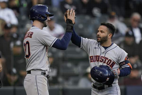 Houston Astros second baseman Jose Altuve, right, celebrates his home run with Kyle Tucker (30) in the ninth inning during Game 4 of a baseball American League Division Series against the Chicago White Sox Tuesday, Oct. 12, 2021, in Chicago. (AP Photo/Nam Y. Huh)
