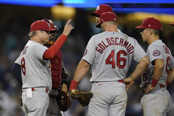 St. Louis Cardinals manager Mike Shildt (8) pulls starting pitcher Adam Wainwright from the game during the sixth inning of a National League Wild Card playoff baseball game against the Los Angeles Dodgers on Wednesday, Oct. 6, 2021, in Los Angeles. (AP Photo/Marcio Jose Sanchez)