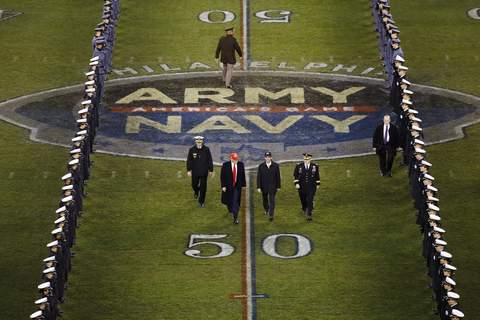 On-Football Playoff Expansion FILE - President Donald Trump and Secretary of Defense Mark Esper cross the field after the first half of an NCAA college football game between Army and Navy in Philadelphia, in this Saturday, Dec. 14, 2019, in file photo. Bump Army-Navy or go head-to-head with NFL? That's the choice facing those in charge with expanding the College Football Playoff if they want to take the format from four to 12 teams. (AP Photo/Matt Rourke, File) (Matt Rourke STF)