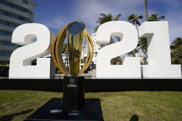 FILE - In this Jan. 7, 2021, file photo, the trophy for the College Football Playoff championship NCAA college football game is displayed along Ocean Drive, in Miami Beach, Fla. The College Football Playoff management committee is scheduled to meet Wednesday, Sept. 22, 2021, to discuss the feedback members have received from campuses since a 12-team expansion plan was unveiled in June. (AP Photo/Lynne Sladky, File)