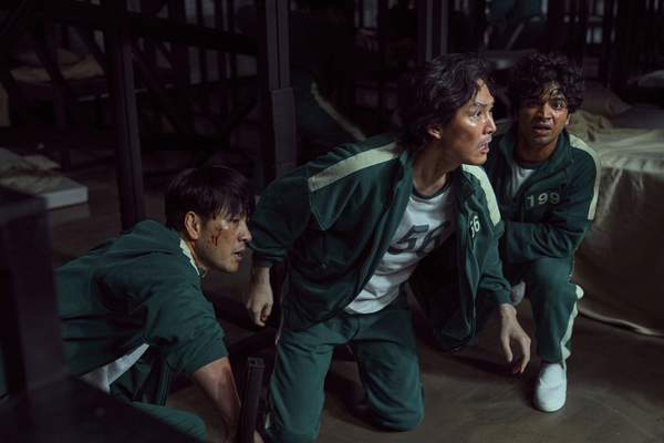 This undated photo released by Netflix shows South Korean cast members, from left, Park Hae-soo, Lee Jung-jae and Anupam Tripathi in a scene from Squid Game. (Youngkyu Park/Netflix via AP)