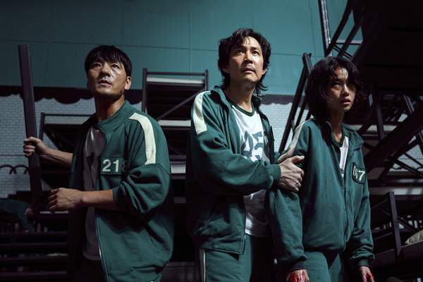 This undated photo released by Netflix shows South Korean cast members, from left, Park Hae-soo, Lee Jung-jae and Jung Ho-yeon in a scene from Squid Game. (Youngkyu Park/Netflix via AP)
