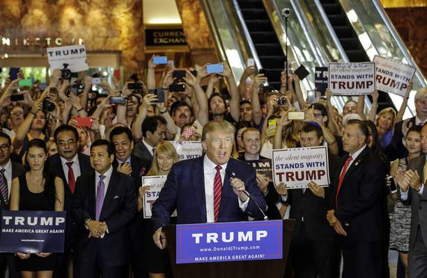 FILE - This Thursday, Sept. 3, 2015, file photo shows then Republican presidential candidate Donald Trump holding a news conference in Trump Tower in New York. (AP Photo/Mark Lennihan, File)