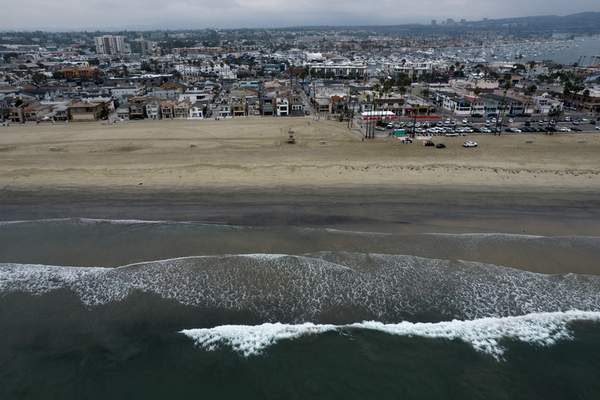 FILE - This Thursday, Oct. 7, 2021, aerial file photo taken with a drone, shows the closed beach after an oil washed up on a beach in Newport Beach, Calif. (AP Photo/Ringo H.W. Chiu, File)