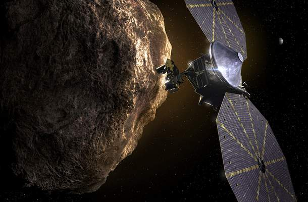 This image provided by the Southwest Research Institute depicts the Lucy spacecraft approaching an asteroid. It will be first space mission to explore a diverse population of small bodies known as the Jupiter Trojan asteroids. (SwRI via AP)