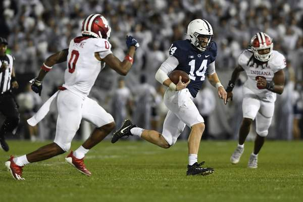 Penn State quarterback Sean Clifford (14) scrambles as Indiana defensive back Raheem Layne II (0) chases him in the second half of their NCAA college football game in State College, Pa., on Saturday, Oct. 2, 2021. Penn State defeated Indiana 24-0. (AP Photo/Barry Reeger)