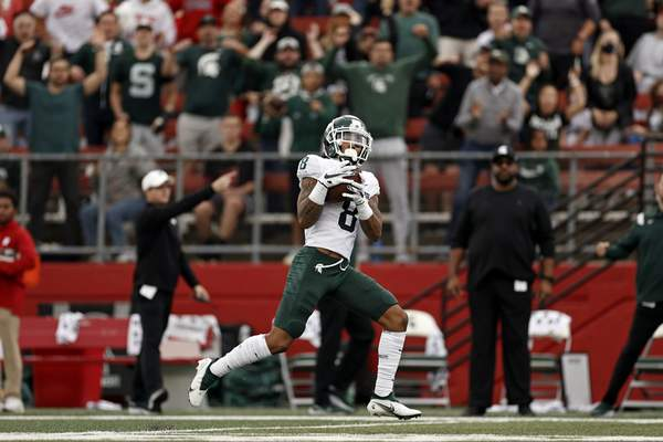 Michigan State wide receiver Jalen Nailor scores a touchdown on a pass play against Rutgers during the first half of an NCAA college football game Saturday, Oct. 9, 2021, in Piscataway, N.J. Michigan State won 31-13. (AP Photo/Adam Hunger)