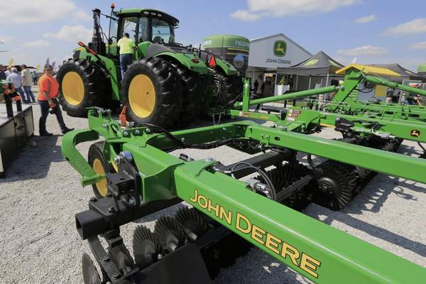 FILE - In this Sept. 10, 2019, file photo a John Deere tractor is on display at the Husker Harvest Days farm show in Grand Island, Neb. (AP Photo/Nati Harnik, File)