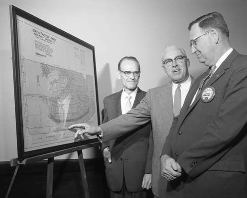 Oct. 30, 1957: Philo T. Farnsworth, left, watches asDale Parkerson, president of Central Lions Club, center, points out the route ofFarnsworth Drive in Brentwood Park to William Gingher, district governor of the Lions. (Journal Gazette file photo)