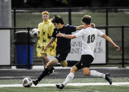 Mike Moore | The Journal Gazette Bishop Dwenger midfielder Tyler Yaggy takes a shot at the goal Thursday during the first half against Yorktown in the Class 2A regional semifinal match at Shields Field.