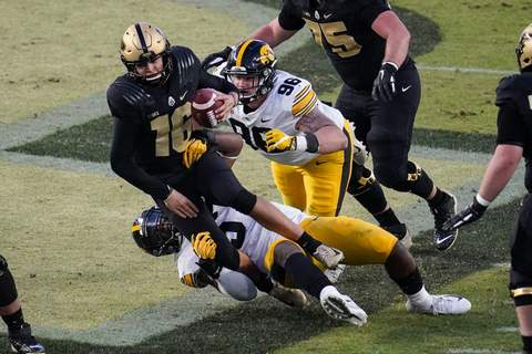 Iowa Heflin Football Associated Press Purdue quarterback Aidan O'Connell is sacked against Iowa last season. Despite that sack, O'Connell led the Boilers to victory that day. (Michael ConroySTF)