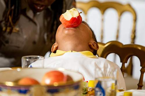 Associated Press Jefferson Lopez-Martinez, then 5, balances an apple in his mouth during a healthy-eating event at the White House in 2015.