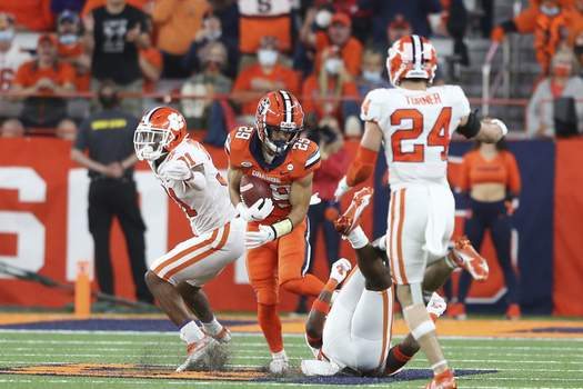 Clemson Syracuse Football Syracuse wide receiver Trebor Pena (29) breaks through several Clemson defenders after a catch, on the way to a touchdown during the fourth quarter of an NCAA football game in Syracuse, N.Y., Friday, Oct. 15, 2021. (AP Photo/Joshua Bessex) (Joshua Bessex FRE)