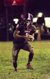 Katie Fyfe | The Journal Gazette Bishop  Luers senior Antwian Lake brings the ball down the field during the second quarter against Snider at Bishop Luers High School on Friday.