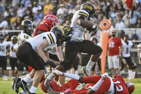 Katie Fyfe | The Journal Gazette  Snider senior Tyrese Brown heads toward the end zone during the second quarter against North Side at North Side High School on Aug. 20.