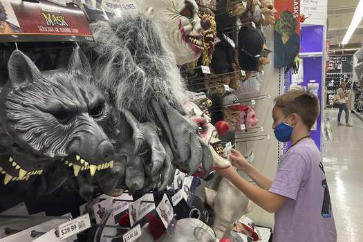 Retail Sales A young customer looks at a Halloween mask at a Party City store, Wednesday, Oct. 6, 2021, in Miami. Americans continued to spend at a solid clip in September despite rising prices and snarled global supply chains that are limiting the flow of goods. Retail sales rose a seasonally adjusted 0.7% in September from the month before, the U.S. Commerce Department said Friday, Oct. 15. (AP Photo/Marta Lavandier) (Marta Lavandier STF)