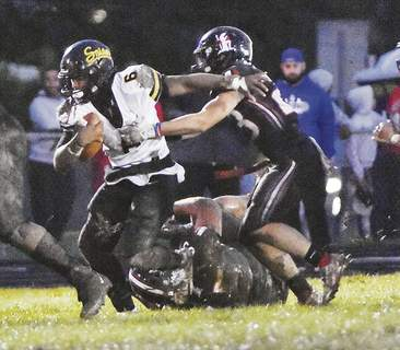 Katie Fyfe | The Journal Gazette Snider senior running back Tyrese Brown tries to shed Bishop Luers tacklers during the first quarter Friday night at Luers. Brown scored three touchdowns in the Panthers' victory.