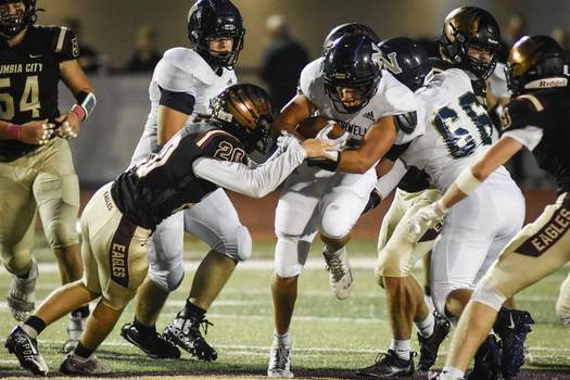 Mike Moore   The Journal Gazette Norwell running back Luke Graft advances the ball Friday in the first quarter against Columbia City.