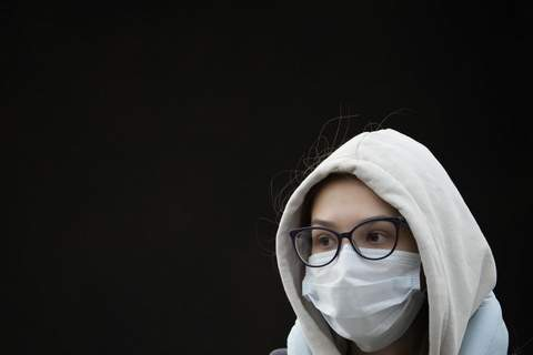 A young woman wearing a face mask to help curb the spread of the coronavirus leaves a subway in Moscow, Russia, Friday, Oct. 15, 2021. (AP Photo/Alexander Zemlianichenko)