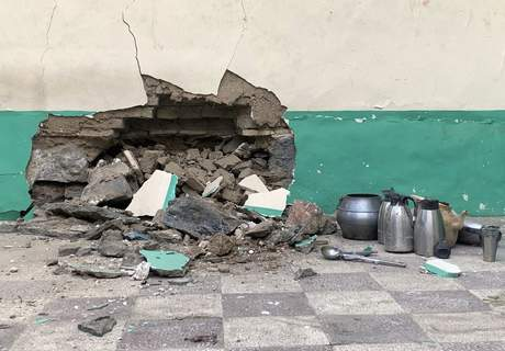 Damaged wall of a mosque is seen following a suicide bombers attack in the city of Kandahar, southwest Afghanistan, Friday, Oct. 15, 2021. (AP Photo/Sidiqullah Khan)