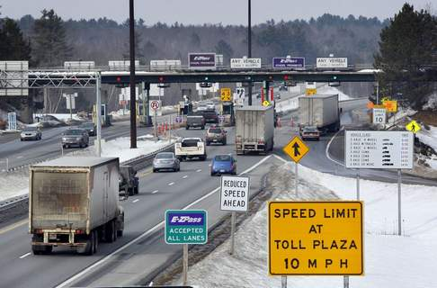 In this Feb. 2011 file photo, traffic approaches Maine Turnpike toll booths in Gardiner, Maine. (AP Photo/Robert F. Bukaty, File)
