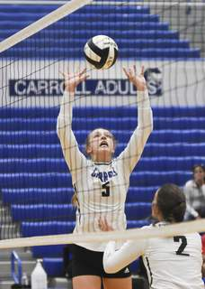 Katie Fyfe | The Journal Gazette Carroll senior Kaley Matney sets the ball during the first set against Snider on Saturday.