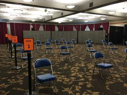 Rosa Salter Rodriguez | The Journal Gazette After getting a COVID-19 booster shot, people will wait in this socially distanced observation area at the Allen County Health Department's vaccination clinic at Memorial Coliseum. The site opens Monday.