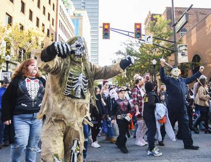 Katie Fyfe | The Journal Gazette Calhoun Street is flooded with monsters during the Zombie Walk as part of Saturday's annual Fright Night event.