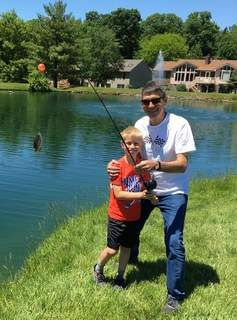 Hudson Kondraschow, 9, of Wheaton, Ill.,poses with his grandfather Jim Weide after catching a bluegill on Memorial Day.