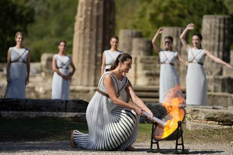 Greece Olympics Beijing Flame Lighting Greek actress Xanthi Georgiou, playing the role of the High Priestess, lights the torch during the lighting of the Olympic flame at Ancient Olympia site, birthplace of the ancient Olympics in southwestern Greece, Monday, Oct. 18, 2021. (AP Photo/Thanassis Stavrakis) (Thanassis Stavrakis STF)