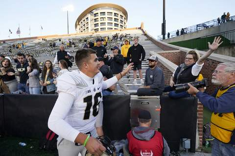 Purdue Iowa Football Associated Press Purdue QB Aidan O'Connell celebrates with fans after the Boilermakers' 24-7 victory over No. 2 Iowa on Saturday. O'Connell completed 30 of 40 passes for 375 yards. (Charlie NeibergallSTF)
