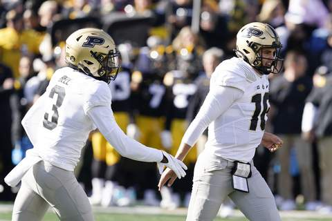 Purdue Iowa Football Associated Press  Purdue quarterback Aidan O'Connell (16) celebrates with teammate wide receiver David Bell (3) after scoring on a 6-yard touchdown run during the first half of an NCAA college football game against Iowa, Saturday, Oct. 16, 2021, in Iowa City, Iowa.  (Charlie NeibergallSTF)