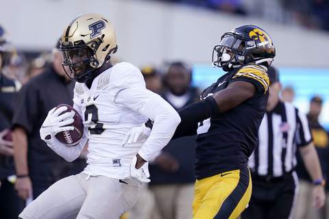 Purdue Iowa Football Purdue wide receiver David Bell (3) runs from Iowa defensive back Matt Hankins, right, after catching a pass during the second half of an NCAA college football game, Saturday, Oct. 16, 2021, in Iowa City, Iowa. Purdue won 24-7. (AP Photo/Charlie Neibergall) (Charlie Neibergall STF)