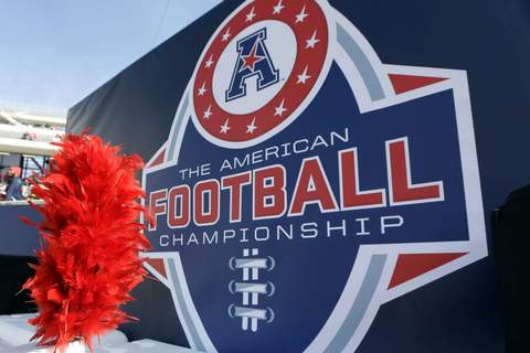 Conference Realignment Football FILE - In this Dec. 5, 2015, file photo, the American Athletic Conference logo is displayed before during the championship NCAA college football game between Houston and Temple in Houston. Six schools from Conference USA â€