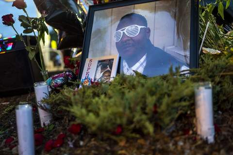 Fatal Police Pursuit Officer Charged FILE - in this July 7, 2021 file photo, Items rest at a memorial for Leneal Lamont Frazier, in Minneapolis, at the site of his death. Frazier died early Tuesday, July 6, after his vehicle was struck by a squad car that police said was pursuing another driver linked to several robberies. A Minneapolis police officer has been charged with manslaughter and vehicular homicide in a fatal crash in July that occurred while the officer was pursuing a stolen vehicle, a prosecutor announced Friday, Oct. 22, 2021. (Antranik Tavitian/Star Tribune via AP File) (Antranik Tavitian MBR)