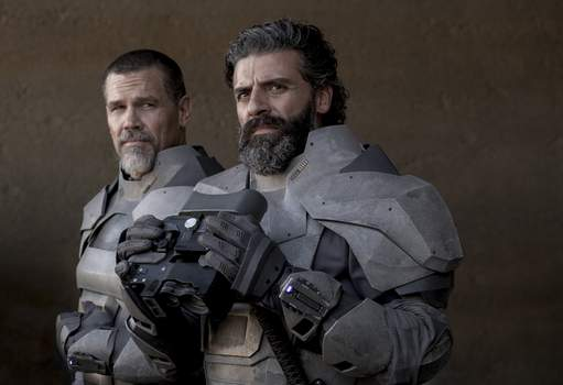 Film Review - Dune This image released by Warner Bros. Pictures shows Josh Brolin, left, and Oscar Isaac in a scene from