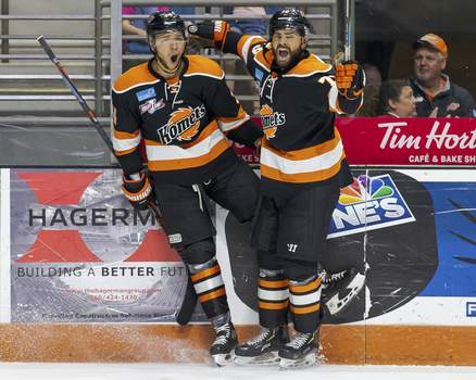 Josh Gales | Special to The Journal Gazette Stephen Harper, left, celebrates a goal last season with Marcus McIvor. They are two of a handful of players back from the Kelly Cup championship team, heading into tonight's 70th season opener at Memorial Coliseum.