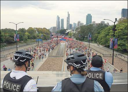 Associated Press Chicago police keep watch during the city's recent marathon.