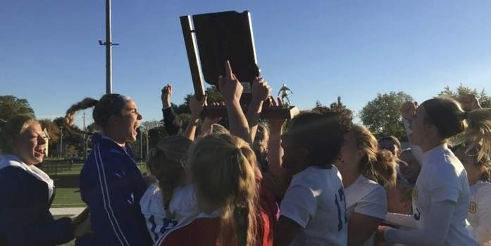 Dylan Sinn | The Journal Gazette  Homestead girls soccer celebrates its semistate victory over South Bend St. Joseph in penalty kicks Saturday. The Spartans won their fifth semistate championship.