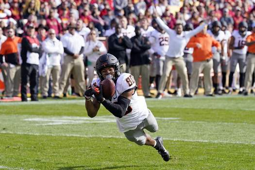 APTOPIX Oklahoma St Iowa St Football Oklahoma State wide receiver Brennan Presley (80) catches a 5-yard touchdown pass during the first half of an NCAA college football game against Iowa State, Saturday, Oct. 23, 2021, in Ames, Iowa. (AP Photo/Charlie Neibergall) (Charlie Neibergall STF)