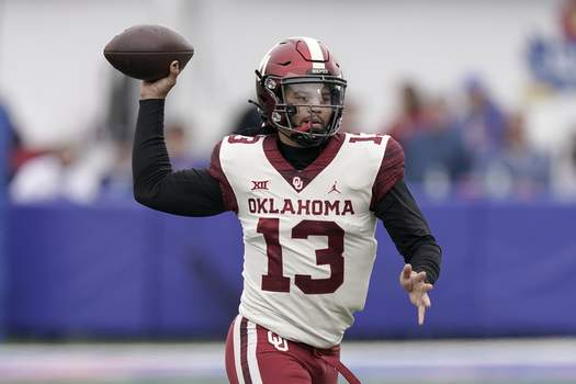 Oklahoma Kansas Football Oklahoma quarterback Caleb Williams passes the ball during the first half of an NCAA college football game against Kansas Saturday, Oct. 23, 2021, in Lawrence, Kan. (AP Photo/Charlie Riedel) (Charlie Riedel STF)
