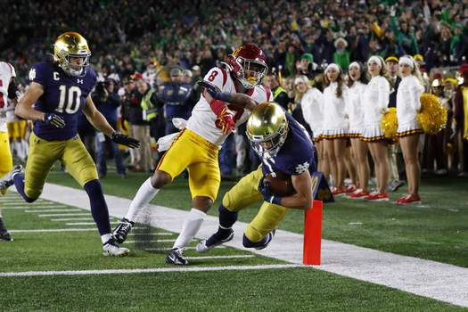 USC Notre Dame Football Notre Dame wide receiver Braden Lenzy (25) scores a touchdown on a 51-yard run as Southern California cornerback Chris Steele (8) defends in the first half of an NCAA college football game in South Bend, Ind., Saturday, Oct. 12, 2019. (AP Photo/Paul Sancya) (Paul Sancya STF)
